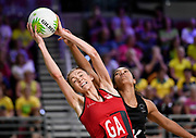 11th April 2018, Gold Coast Convention and Exhibition Centre, Gold Coast, Australia; Commonwealth Games day 7; Netball, England versus New Zealand; Temalisi Fakahokotau of New Zealand can only look on as Helen Housby of England  stretches to catch the ball