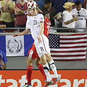 USA defender Clarence Goodson (21) heads the ball past Panama forward Blas Pérez (7)during a  CONCACAF Gold Cup soccer match between the United States and Panama on Saturday, June 11, 2011, at Raymond James Stadium in Tampa, Fla. (AP Photo/Alex Menendez)