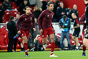 Liverpool defender Virgil van Dijk (4) and Liverpool defender Joel Matip (32) warming up during the Champions League Group C match between Liverpool and Napoli at Anfield, Liverpool, England on 11 December 2018.
