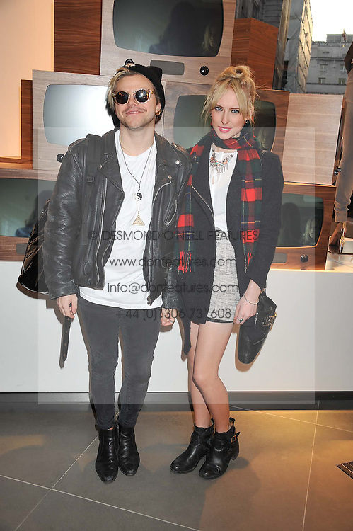 VINCE KIDD and AISLING JARRETT at an invitation-only acoustic performance by Rita Ora hosted by Calvin Klein Jeans at their Regent Street Store, London on 18th February 2013.