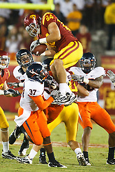 September 11, 2010; Los Angeles, CA, USA;  Southern California Trojans tight end Jordan Cameron (84) recovers an onside kick to end the game against the Virginia Cavaliers at the Los Angeles Memorial Coliseum.  USC defeated Virginia 17-14.