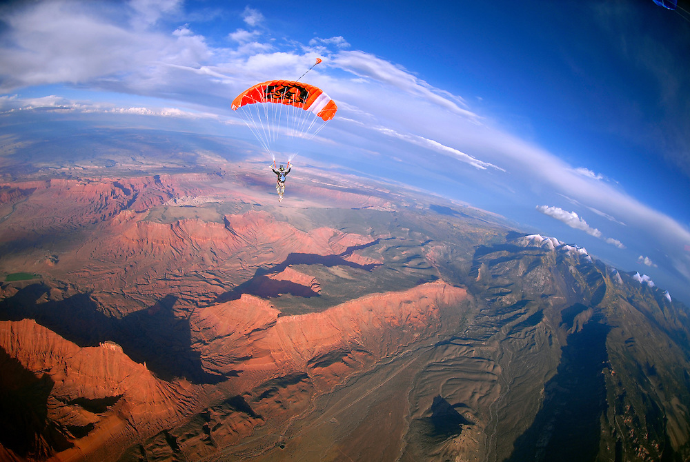 Alan Martinez flies high above Castleton Tower, Fisher Towers, and the freshly dusted La Sal mountains during the 2008 M.O.A.B. Boogie.  Castle Valley, Utah.