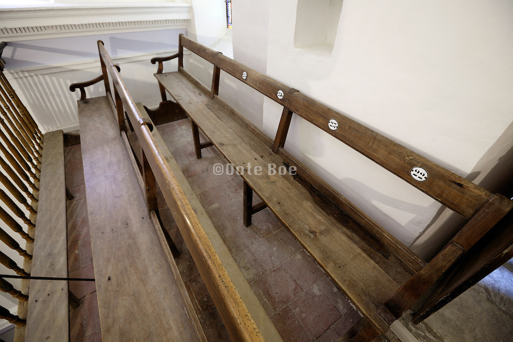 old wooden benches in a small rural church