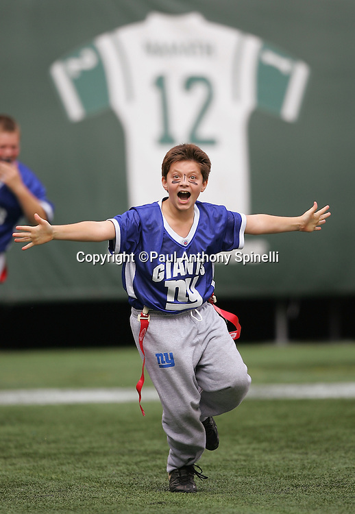 EAST RUTHERFORD, NJ - OCTOBER 1:  A young flag football celebrates after scoring a touchdown during an NFL Flag football exhibition at halftime of the New York Jets game against the Indianapolis Colts at the Meadowlands on October 1, 2006 in East Rutherford, New Jersey. The Colts defeated the Jets 31-28. ©Paul Anthony Spinelli