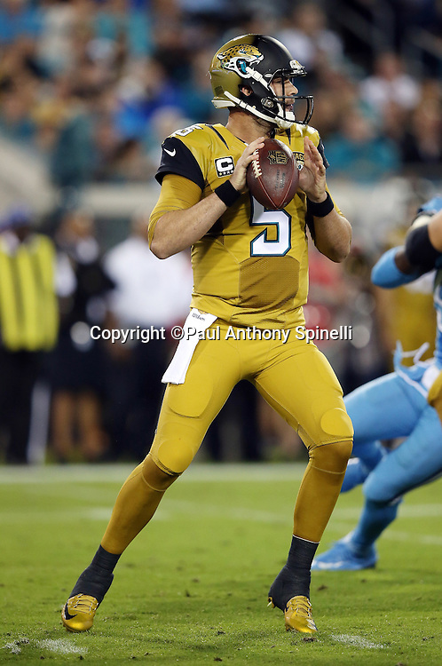 Jacksonville Jaguars quarterback Blake Bortles (5) drops back to pass during the 2015 week 11 regular season NFL football game against the Tennessee Titans on Thursday, Nov. 19, 2015 in Jacksonville, Fla. The Jaguars won the game 19-13. (©Paul Anthony Spinelli)