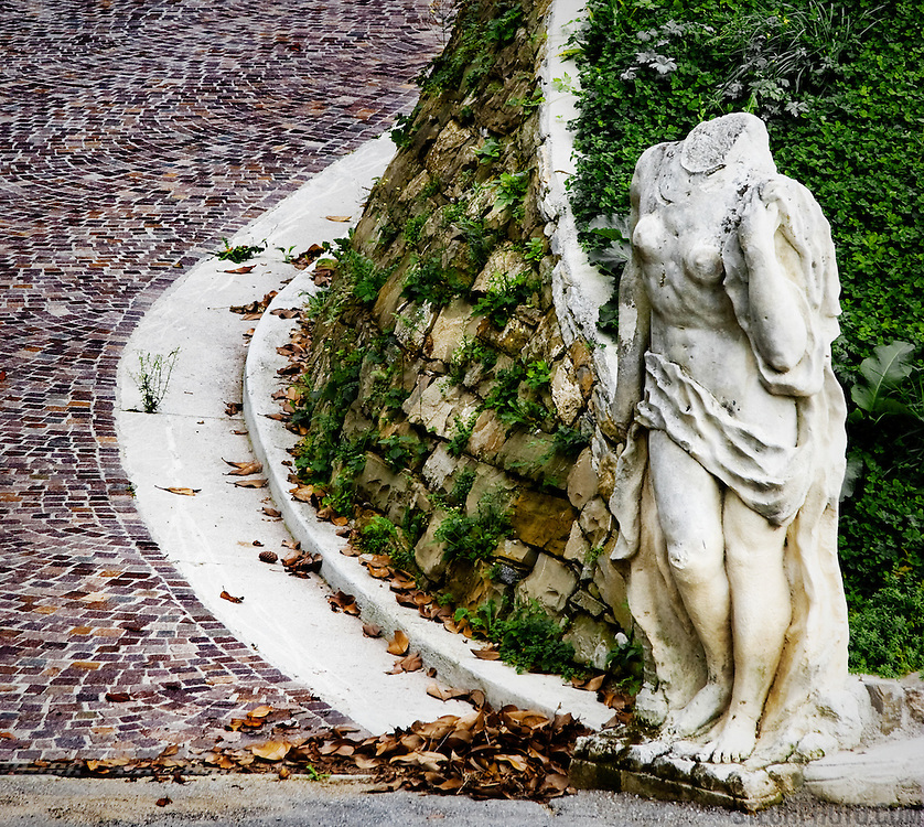 A headless statue by the road in Tarcento, Italy.