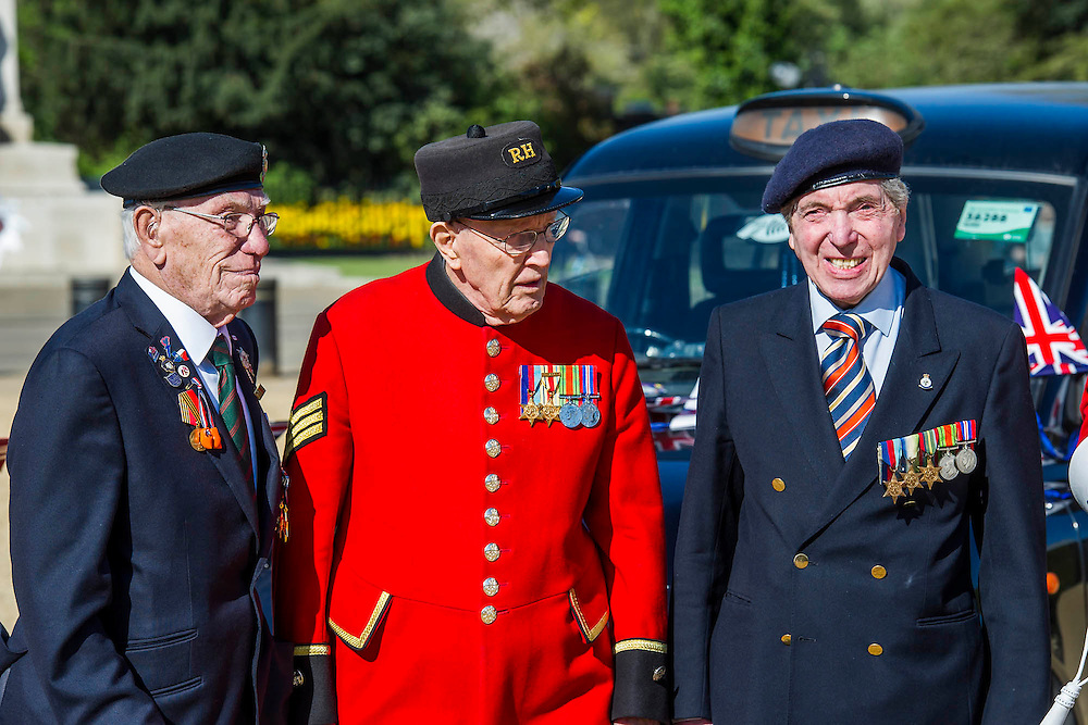 Charles Jeffries, 93 D-day/Dessert Rat, John Cuthbert, 92, Peter Kent, 90 Royal Navy (L to R) - Second World War Veterans, Reg Wilderspin (89) and John Cuthbert (92), and serving Guardsmen on Horse Guards Parade Ground to highlight Royal British Legion events on Victory in Europe (VE) Day. The Legion is also announcing that veterans and their carers will receive funding towards attending the event on the weekend of the 8-10th May.<br /> <br /> Places will be available for a series of commemorative events over the weekend including on VE Day itself, Friday 8 May, when a Service of Remembrance will be held at The Cenotaph, with a national two minute silence at 3pm. On Sunday 10 May, there will a Service of Thanksgiving at 11am at Westminster Abbey attended by HM The Queen, followed by a parade from the Abbey to Horse Guards Parade and into St James's Park, where the Legion will host a lunch reception for the veterans.