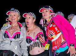 Pictured: Moonwalk Scotland, Edinburgh, Scotland, United Kingdom, 08 June 2019. The 14th Moonwalk Scotland 'Walk the Walk' night-time event with several thousand participants wearing specially decorated bras with a circus theme choose between New Moon (6.55 Miles), Half Moon Marathon (13.1 Miles), Full Moon Marathon (26.2 miles) and Over The Moon (52.4 Miles) to raise money  and awareness for breast cancer causes. Moonwalkers get ready to set off.<br /> <br /> Sally Anderson | EdinburghElitemedia.co.uk