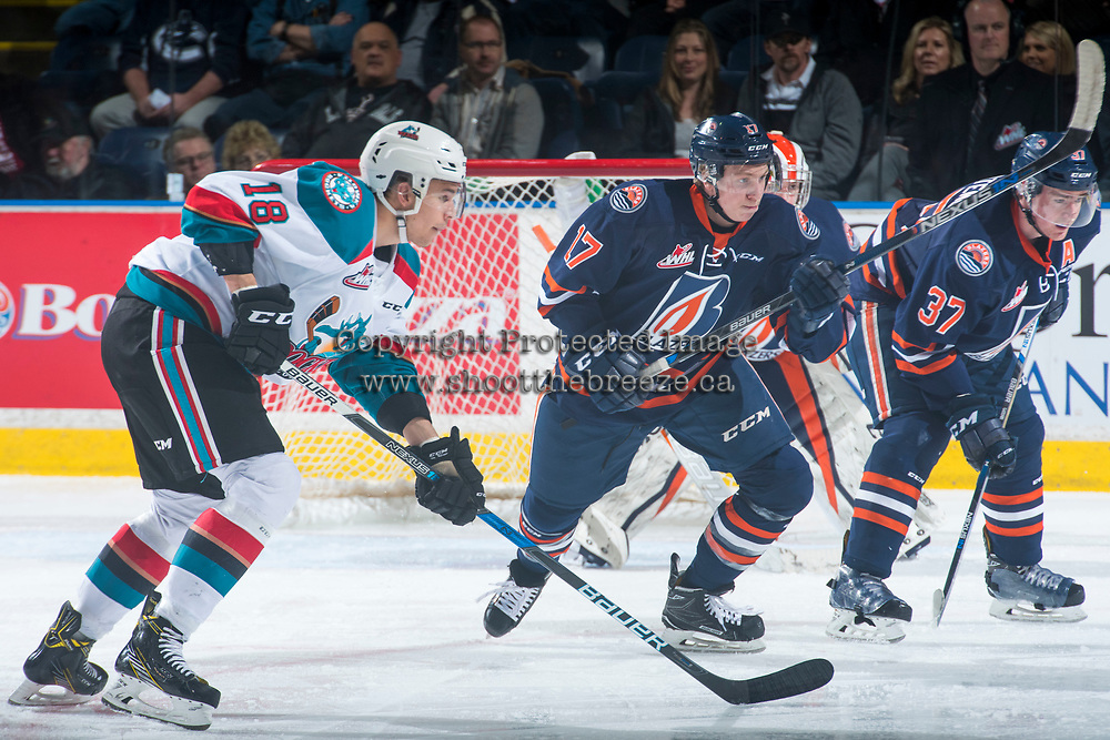KELOWNA, CANADA - MARCH 25: Brodi Stuart #17 of the Kamloops Blazers is checked by Carsen Twarynski #18 of the Kelowna Rockets on March 25, 2017 at Prospera Place in Kelowna, British Columbia, Canada.  (Photo by Marissa Baecker/Shoot the Breeze)  *** Local Caption ***
