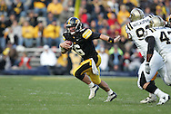 17 NOVEMBER 2007: Iowa quarterback Jake Christensen (6) scrambles away from the defense in Western Michigan's 28-19 win over Iowa at Kinnick Stadium in Iowa City, Iowa on November 17, 2007.