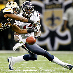 September 25, 2011; New Orleans, LA, USA; New Orleans Saints cornerback Jabari Greer (33) breaks up a pass intended for Houston Texans wide receiver Jacoby Jones (12) during the fourth quarter at the Louisiana Superdome. The Saints defeated the Texans 40-33. Mandatory Credit: Derick E. Hingle