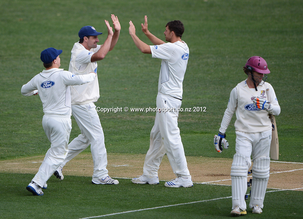 Auckland bowler Dean Bartlett celebrates the wicket of James Marshall with Auckland team mates. Plunket Shield Cricket, Auckland Aces v Northern Knights at Eden Park Outer Oval. Monday 12 November 2012. Photo: Andrew Cornaga/Photosport.co.nz