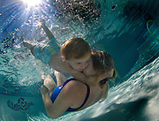 Josiah Northey, 2 1/ 2 years old, holds on as his mother Colleen Northey swims underwater at the Sea Otter Swim School in Loomis. The two of them along with others were enjoying a sunny day. July 26, 2010.