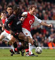 Photo. Javier Garcia<br />02/03/2003 Arsenal v Charlton, FA Barclaycard Premiership, Highbury<br />Charlton's Chris Powell challenges fit again Freddie Ljungberg
