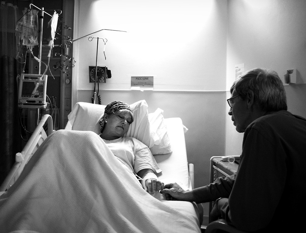 Pastor Barry Heath, Director of Pastoral Care at Salem Hospital, vists with Debra Current, a patient with lymphoma.
