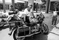 Roma  1985.Motociclista su una Moto Guzzi, Autostrada Roma-Firenze.Motorcycle on a Moto Guzzi, Highway Rome-Florence