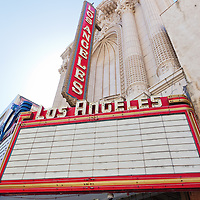 Photo of Los Angeles Theatre marquee sign. The Los Angeles Theatre was built in 1931 and is a National Register landmark located in the Los Angeles Broadway Historic Theatre District.