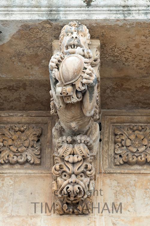 Ancient stone mythical lion and gargoyle on Palazzo Nicolaci di Valladorata in Baroque Noto city, Sicily