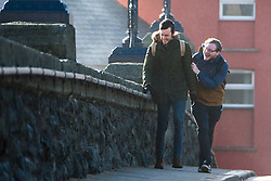 © London News Pictures. 23/02/2017. Aberystwyth,UK. Pedestrians struggle to walk in high winds caused by storm Doris, on the streets of Aberystwyth this morning.  Violent Storm Force 11 winds, with gusts of  of up to 90mph are forecast for parts of North Wales and NorthWest England, with the risk of damage to property and severe disruption to travel. Photo credit: Keith Morris/LNP