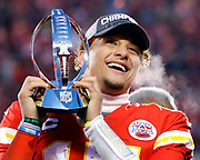 Kansas City Chiefs quarterback Patrick Mahomes holds the Lamar Hunt Trophy during celebrations after winning the NFL, AFC Championship football game against the Tennessee Titans, Sunday, Jan. 19, 2020, in Kansas City, MO. The Chiefs won 35-24 to advance to Super Bowl 54. (AP Photo/Colin E. Braley)