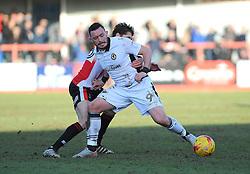 Craig Reid of Newport County  competes with James Rowe of Cheltenham Town- Mandatory by-line: Nizaam Jones/JMP - 04/02/2017 - FOOTBALL - LCI Rail Stadium - Cheltenham, England - Cheltenham Town v Newport County - Sky Bet League Two