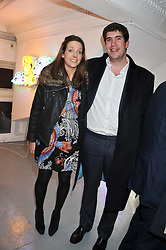 MARTHA BEAUMONT and the HON.ARTHUR VESTEY at a Contemporary Art evening hosted by NUBA Art Ltd entitles 'It's a Material World' held at London West Bank Gallery, 133-137 Westbourne Grove, London W11 on 1st December 2011.