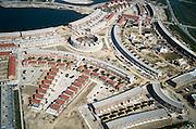 Nederland, Utrecht, Houten, 04-04-2002; recente nieuwbouwwijk in deze overloop gemeente ten Z van Utrecht, rechtsboven de rondweg op de grens stad -platteland en restant Vlowijkerpolder; het water is speciaal aangelegd en dient als recreatie plas; eengezins woningen, wonen, woningbouw, nieuwbouw, woningnood, verstedelijking, urbanisatie, planologie, infrastructuur, landschap.<br /> luchtfoto (toeslag), aerial photo (additional fee)<br /> photo/foto Siebe Swart