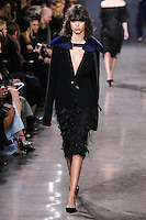 Mica Arganaraz walks the runway wearing Jason Wu Fall 2016, Hair by Paul Hanlon for Morocconoil, Makeup by Yadim for Maybelline, shot by Thomas Concordia during New York Fashion Week on February 12, 2016