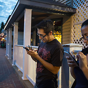 OCCOQUAN, VA - AUG4: Siblings Richard and Mayra Gutierrez, play Pokemon Go in Occoquan, Virginia, August 4th, 2016. This sleepy Virginia town has become a hotspot for Pokemon Go. Throughout the night, kids and young adults play the game on the streets, leaving beer bottles and litter behind. A few residents have complained to city hall and now the city is hiring extra police officers to handle the new masses. (Photo by Evelyn Hockstein/For The Washington Post)