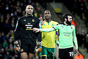 Wolverhampton Wanderers midfielder Jack Price (19) restrains Wolverhampton Wanderers goalkeeper Carl Ikeme (1) before he got sent off during the EFL Sky Bet Championship match between Norwich City and Wolverhampton Wanderers at Carrow Road, Norwich, England on 21 January 2017. Photo by Nigel Cole.
