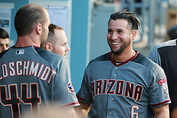 April 13, 2018 - Los Angeles, CA, U.S. - LOS ANGELES, CA - APRIL 13: Arizona Diamondbacks Left field David Peralta (6) shares a laugh with Arizona Diamondbacks First base Paul Goldschmidt (44) in the dugout before the game between the Arizona Diamondbacks and Los Angeles Dodgers on April 13, 2018, at Dodger Stadium in Los Angeles, CA.(Photo by Peter Joneleit/Icon Sportswire) (Credit Image: © Peter Joneleit/Icon SMI via ZUMA Press)