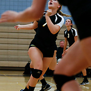 On Friday, November 4, during the Golden West College vs. Irvine Valley College women's volleyball game, Breana Torres (7) on Golden West, tracks the ball as she gets ready to set the ball to her outside hitter in Irvine, CA. Golden West won all three games against Irvine Valley College. <br /> <br />  Photograph taken by ©Mikailin Rae Perry, Sports Shooter Academy