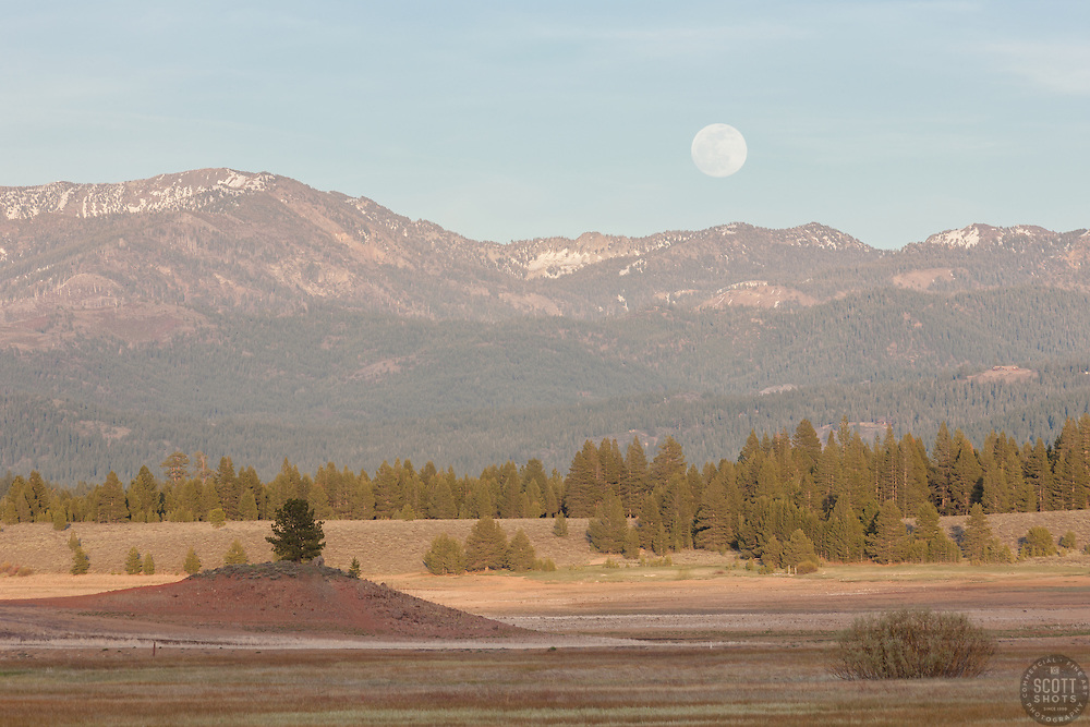 """Full Moon Over Prosser 1"" - Photograph of a full moon rising over the mountains at a very low Prosser Reservoir near Truckee, California."