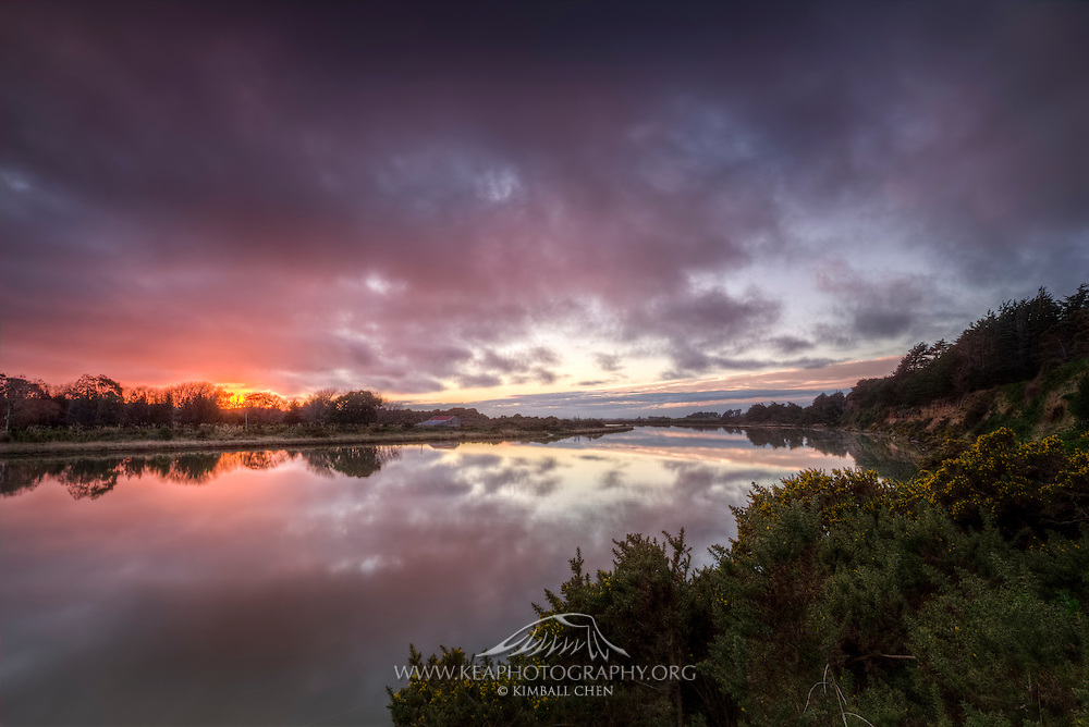 The mighty Oreti River at sunset, Invercargill, New Zealand.
