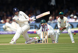 England's Joe Root hits out for four runs during day three of the First NatWest Test Series match at Lord's, London.