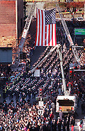 TGFIRE  An american flag hangs over the procession as it heads down Central St. to the Centrum. Shoot date 12/9/99
