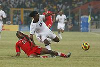 Photo: Steve Bond/Richard Lane Photography.<br />Ghana v Namibia. Africa Cup of Nations. 24/01/2008. Baffour Gyan (R) goes to ground under a challange by Jamunovamdu Ngatjizeko (L)