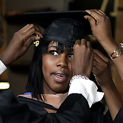 New York, NY / 2009 - Jessica Toutebon, 22, gets hands-on help adjusting her cap before the Monroe College graduation ceremony at Madison Square Garden in New York City June 12. ( Mike Roy / The Journal News )