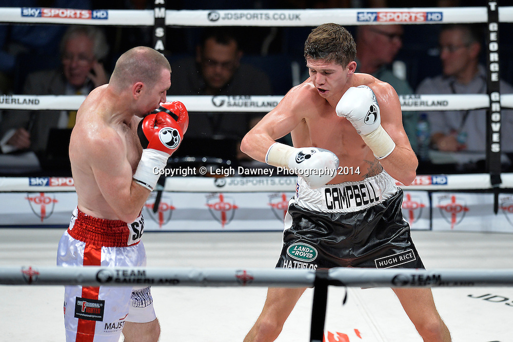 Luke Campbell (black shorts) defeats Krzysztof Szot in a Lightweight contest at the SSE Wembley Arena, London on the 20th September 2014. Sauerland Promotions. Credit: Leigh Dawney Photography.