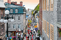 Visitors walk the narrow cobblestone roads of Petit Champlain district in old Quebec City on an early autumn evening.