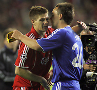 Photo: Paul Thomas.<br /> Liverpool v Chelsea. UEFA Champions League. Semi Final, 2nd Leg. 01/05/2007.<br /> <br /> Captain's Steven Gerrard (L) of Liverpool and John Terry hug after the end.