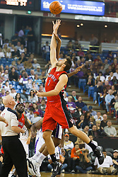 November 1, 2010; Sacramento, CA, USA;  Toronto Raptors center Andrea Bargnani (7) wins the opening tip off against the Sacramento Kings during the first quarter at ARCO Arena. The Kings defeated the Raptors 111-108.