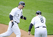 CHICAGO - JUNE 06:  Josh Fields #7 of the Chicago White Sox is congratulated by third base coach Jeff Cox #8 after Fields hit a fourth inning home run against the Cleveland Indians on June 6, 2009 at U.S. Cellular Field in Chicago, Illinois.  The White Sox defeated the Indians 4-2.  (Photo by Ron Vesely)