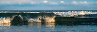 Waves crash on the beach of Northern California.