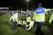 Police tackle fan on pitch during the The FA Cup match between Sutton United and Arsenal at Gander Green Lane, Sutton, United Kingdom on 20 February 2017. Photo by Phil Duncan.