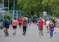 © Licensed to London News Pictures. 02/05/2020. London, UK. After the wind and rain, runners, walkers and cyclists  go out to enjoy the warmer weather on a busy Putney Embankment during lockdown where temperatures are expected to reach 18c this weekend. Prime Minister Boris Johnson will announce any further measures of relaxing lockdown on 7th of May as the coronavirus pandemic crisis continues. Photo credit: Alex Lentati/LNP