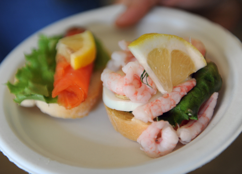 Swedish open face shrimp and salmon sandwiches were offered at the Smorgasbord Nordic Food Festival, held at the Scandinavian Cultural Center in Newton, Sept. 20, 2014. <br /> Wicked Local staff photo / Kate Flock