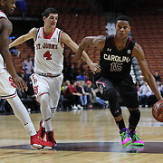 PJ Dozier, (right), South Carolina, drives past Federico Mussini, St. John's, during the St. John's vs South Carolina Men's College Basketball game in the Hall of Fame Shootout Tournament at Mohegan Sun Arena, Uncasville, Connecticut, USA. 22nd December 2015. Photo Tim Clayton