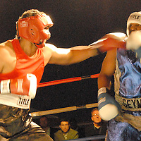 Amateur Heavyweights Shawn Seymore (right) and Dominic Brezeale  box during ``Big Fighters, Big Cause'' charity boxing event at the Santa Monica Pier on Tuesday, May 25, 2010. Seymore won the bout by decision.