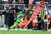 Seattle Seahawks wide receiver Doug Baldwin (89) races down the sideline after Arizona Cardinals strong safety Antoine Bethea (41) falls to the ground trying to break up a fourth quarter pass play good for a gain of 54 yards and goal during the 2017 NFL week 10 regular season football game against the Arizona Cardinals, Thursday, Nov. 9, 2017 in Glendale, Ariz. The Seahawks won the game 22-16. (©Paul Anthony Spinelli)